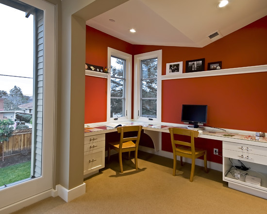 study room design with white furniture and orange wall paint color