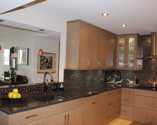 black tile backsplash and granite countertop solid wood cabinetry